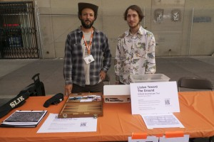 Jeremiah Moore and Jordan Sawyer checking out sound players at ISEA 2012, in downtown Albuquerque